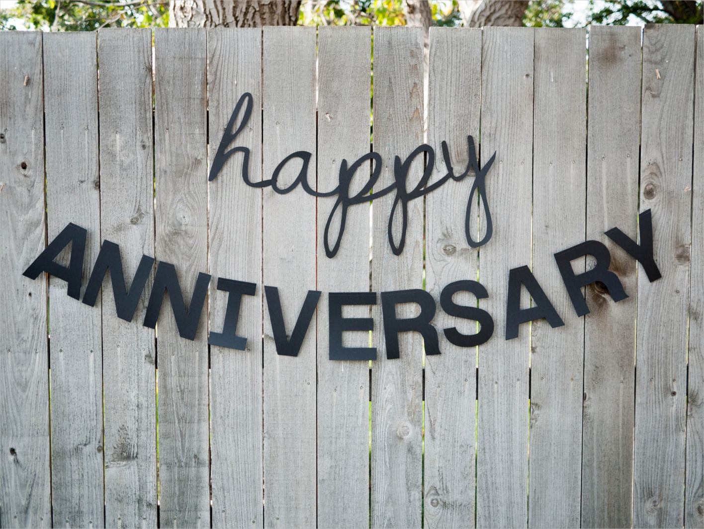 anniversary banner in a wooden plank