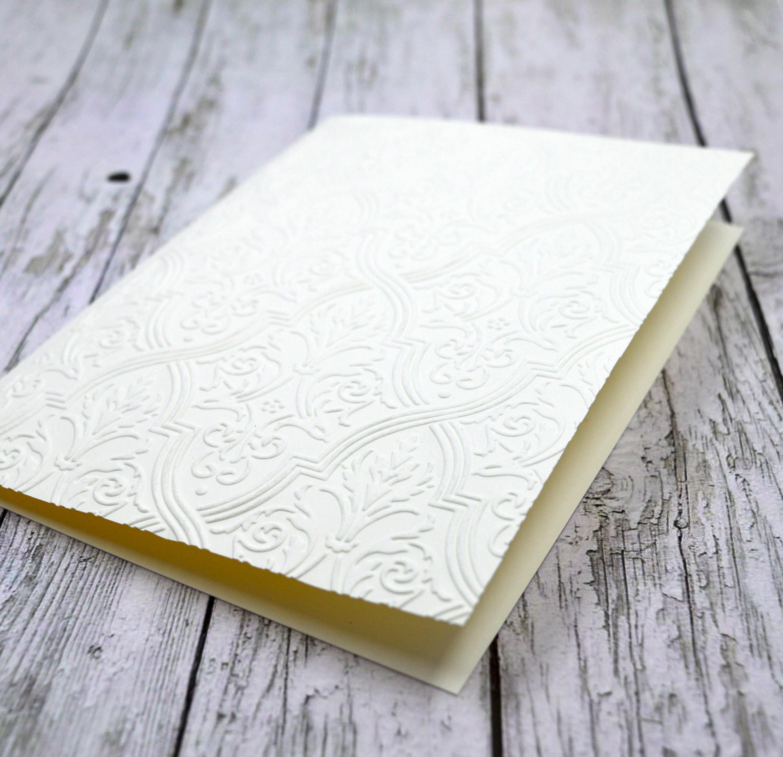 blank embossed wedding invitation