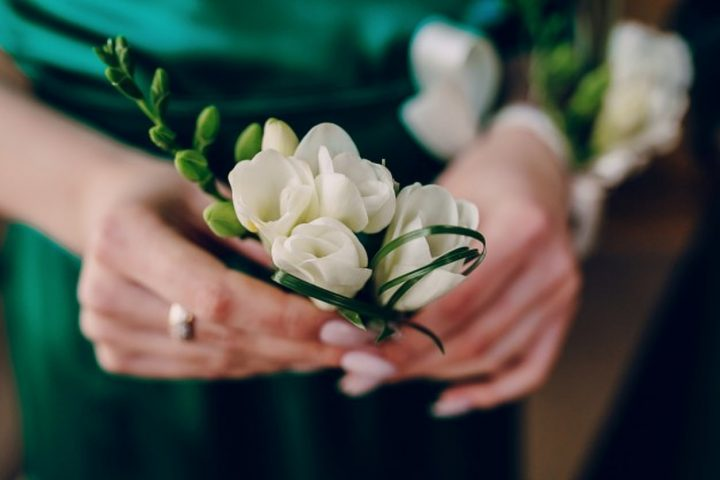 hands with a white flower