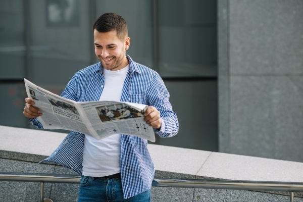 holding newspaper