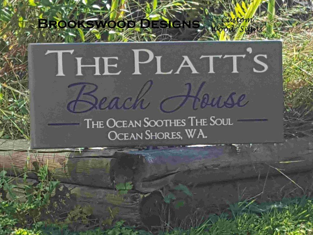 carved outdoor beach house sign example