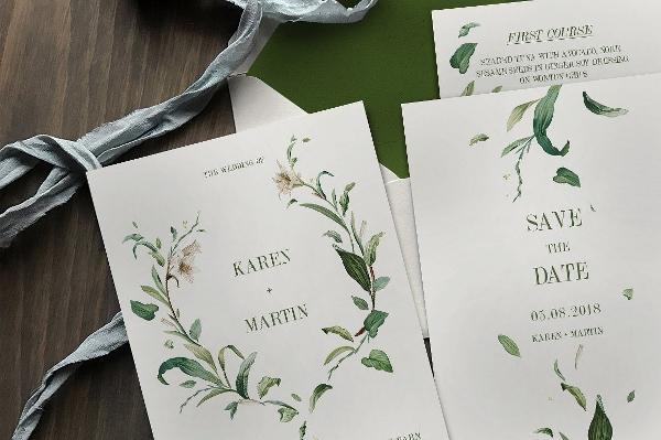 green foliage wedding suite invitation card