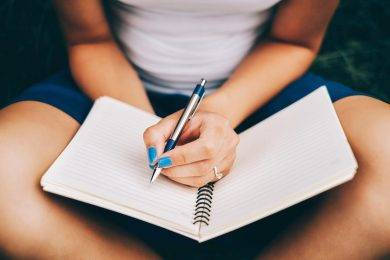person with pen and notebook