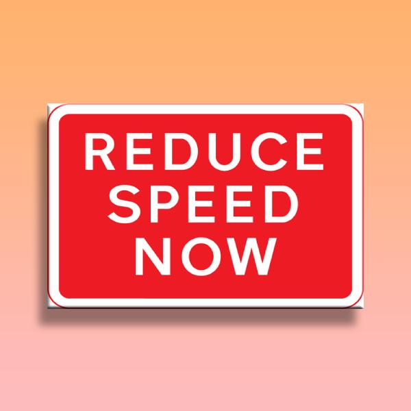 reduce speed warning sign