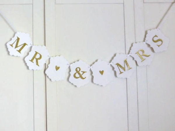white and gold wedding banner